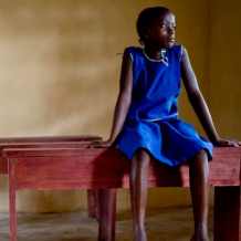 Young girl on a school desk